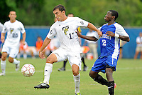 2 October 2011:  FIU midfielder/forward Mario Uribe (17) battles Kentucky forward Cameron Wilder (12) for the ball in the second half as the FIU Golden Panthers defeated the University of Kentucky Wildcats, 1-0 in overtime, at University Park Stadium in Miami, Florida.
