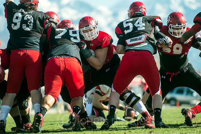 Chris Detrick  |  The Salt Lake Tribune<br /> Utah's Jackson Barton runs drills against Likio Pope (79) and Isaac Asiata (54) during a practice at the field west of the Spence &amp; Cleone Eccles Football Center Wednesday March 26, 2014.