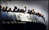 Workers at the Ferguson yard at Port Glasgow - the last independant shipyard on the River Clyde - wave as the latest vessel to be launched, the oil industry tug and supply ship, the MV Stirling Jura, takes to the water   .... Pic Donald MacLeod 18.10.01