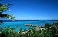 Huts extend into tropical water, Tahiti, Bora Bora, French Polynesia, South Pacific on holiday