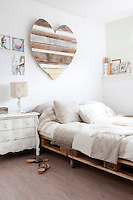 The master bedroom, with its pallet bed and other salvaged bits and pieces, is a cosy space with a homespun feel