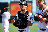 Baltimore Orioles catcher Austin Wynns (61) and starting pitcher Andrew Cashner (54) walk to the dugout before a Grapefruit League Spring Training game against the Detroit Tigers on March 3, 2019 at Ed Smith Stadium in Sarasota, Florida.  Baltimore defeated Detroit 7-5.  (Mike Janes/Four Seam Images)