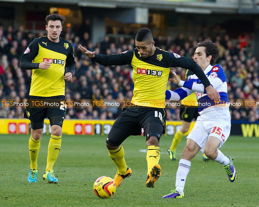 Lewis McGugan of Watford attempts to clear under pressure from Yossi Benayoun of Queens Park Rangers - Watford vs Queens Park Rangers - Sky Bet Championship Football at Vicarage Road Stadium, Watford, Hertfordshire - 29/12/13 - MANDATORY CREDIT: Ray Lawrence/TGSPHOTO - Self billing applies where appropriate - 0845 094 6026 - contact@tgsphoto.co.uk - NO UNPAID USE