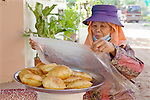 Woman Selling Fried Dough