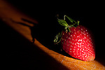 29 January 2010 -- Daily picture for January 29, 2010. Strawberry caught in light. PHOTO/Daniel Johnson (Copyright 2010 Daniel Johnson)