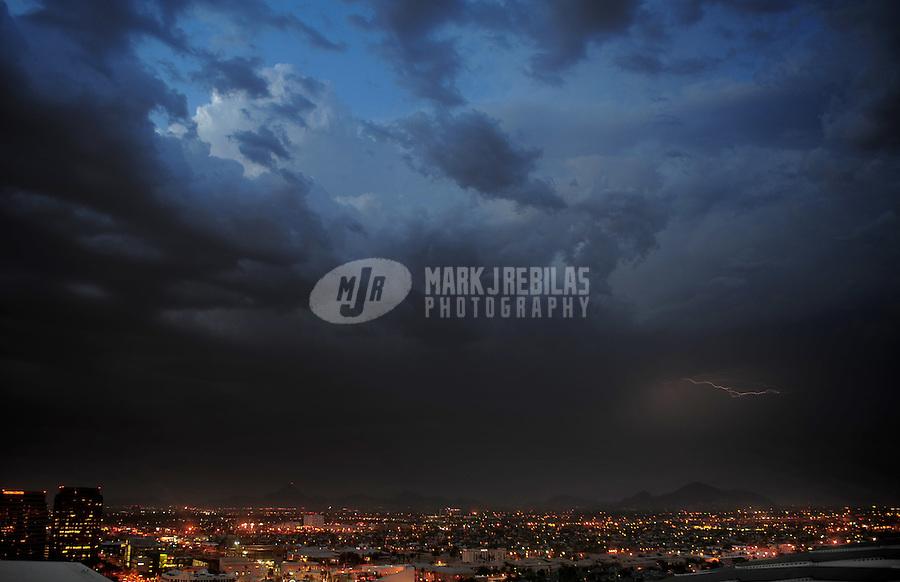 Lightning strike bolt thunderstorm monsoon storm thunderstorm Phoenix Arizona city sky lights urban chaser chasing building mountain
