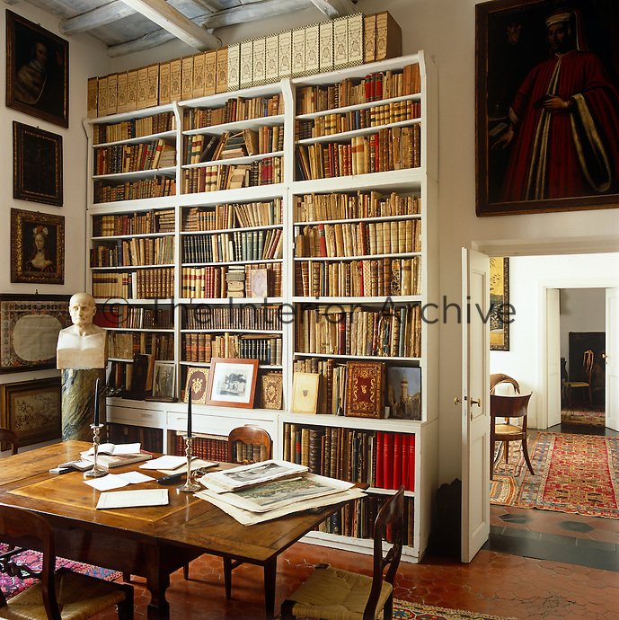 The library which doubles as a dining room is dominated by a large floor-to-ceiling bookshelf in the library and adjoins the salon