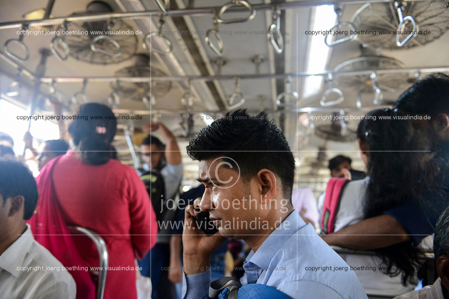 INDIA, Mumbai, inside suburban train Western Railway WR, commuter travel between suburbans and city centre