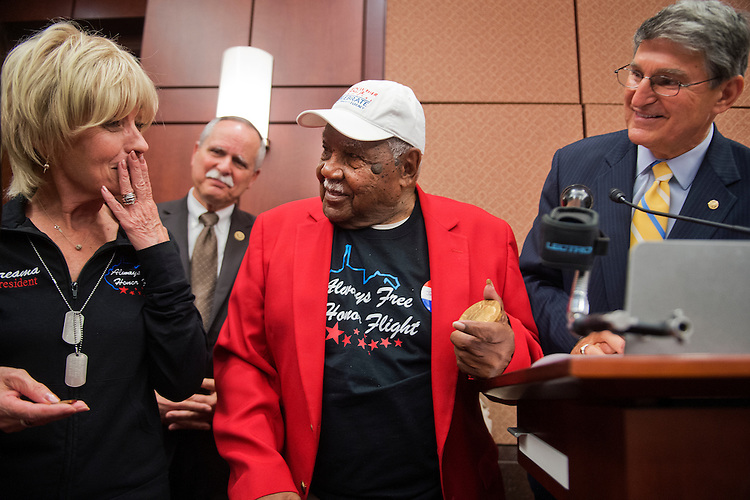 UNITED STATES - MAY 20: Dreama Denver, left, of Always Free Honor Flight, becomes emotional during a luncheon for Sgt. John M. Watson, center, 96, of Beckley, W.Va., in the Capitol Visitor Center where Watson received a Congressional Gold Medal and was recognized by the Tuskegee Airmen Association, May 20, 2015. Rep. David McKinley, R-W.Va., left, and Sen. Joe Manchin, D-W.Va., are also pictured. (Photo By Tom Williams/CQ Roll Call)