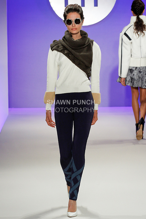 Model walks runway in an outfit by Jennifer Nazath, during the FIT Future of Fashion 2014 Graduates' Collection fashion show, at the Fashion Institute of Technology on May 1, 2014.