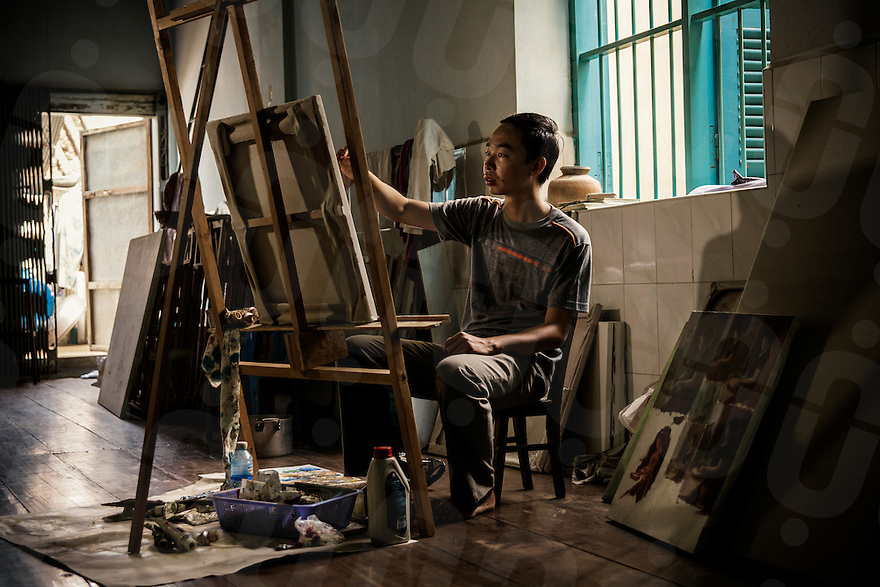 25/06/2012 - Battambang. Theanly Chov, another young painter working in his studio in Battambang.