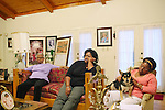 Maxine McNair (left to right) sits next to her daughters Kimberly Brock and Lisa McNair in her Birmingham, Alabama home August 13, 2013. Maxine's daughter Denise McNair was the youngest victim who died in a bomb blast at 16th Street Baptist Church September 15, 1963.