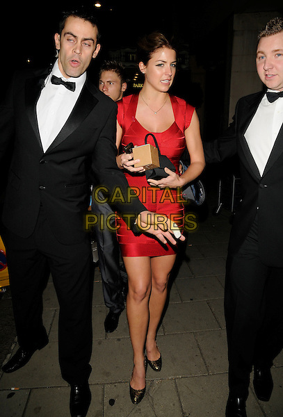 GEMMA ATKINSON & minders.Leaving the TV Quick & TV Choice Awards, Dorchester Hotel, London, England..September 7th, 2009.full length red dress bandau gold leopard print shoes box .CAP/CAN.©Can Nguyen/Capital Pictures.