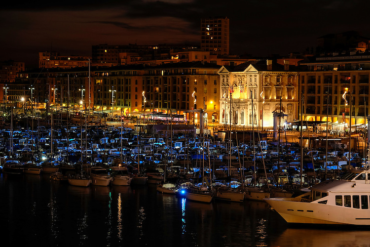 In the darkness of evening, the Old Port area becomes a kaleidoscope of blue and golden colors.