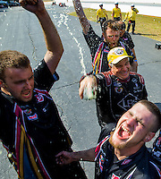 May 17, 2015; Commerce, GA, USA; NHRA funny car driver Tim Wilkerson (middle right) celebrates with his crew after winning the Southern Nationals at Atlanta Dragway. Mandatory Credit: Mark J. Rebilas-USA TODAY Sports