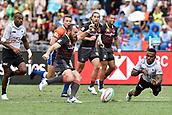 2nd February 2019, Spotless Stadium, Sydney, Australia; HSBC Sydney Rugby Sevens; England versus Fiji; Harry Glover of England kicks the ball as Waisea Nacuqu of Fiji dives to block