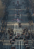 The presidential motorcade takes part in the Inaugural parade on its way down Pennsylvania Ave. from the US Capitol on January 21, 2013, in Washington, DC. US President Barack Obama and Vice President Joe Biden were sworn in for a second term and are will watch the parade from a viewing stand in front of The White House.  .Credit: Molly Riley / Pool via CNP