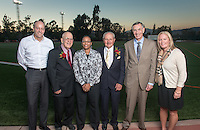 From left, Occidental College President Jonathan Veitch stands next to Athletics Hall of Fame inductees Bob Ashford '52, Shawn Lawson-Cummings '86, Ted Tiffany '57, John McGrath '63 and Director of Athletics Jaime Hoffman on Patterson Field in Kemp Stadium, Oct. 24, 2014. Also inducted were: Roy Dennis '33, Maxine McMasters Mitchell '45 and John Barnes '52. The recognition event was part of Homecoming weekend. (Photo by Marc Campos, Occidental College Photographer)