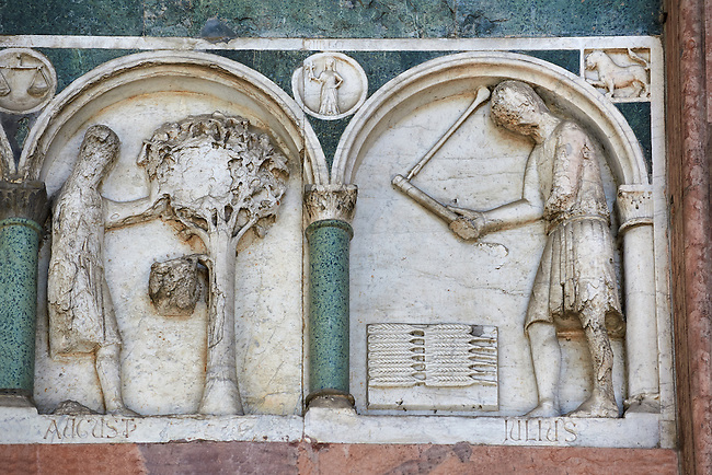 Late medieval relief sculpture depicting the labours for August and July and astrological signs on the Facade of the Cattedrale di San Martino,  Duomo of Lucca, Tunscany, Italy,