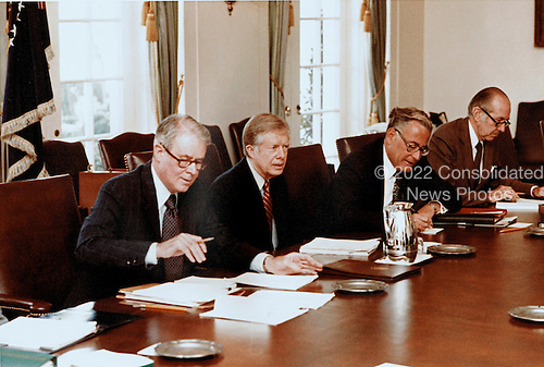 United States President Jimmy Carter returned from Camp David, the Presidential retreat near Thurmont, Maryland, to meet with his National Security Council concerning the crisis in Iran and the Soviet invasion of Afghanistan in the Cabinet Room of the White House in Washington, DC on January 2, 1980.  Pictured with the President are US Secretary of State Cyrus Vance, left, and US Secretary of Defense Harold Brown, right.  In response to the crisis only United Nations sanctions have been proposed but members of the Carter Administration are considering other measures to gain the release of the American hostages in Iran and sanctions against the Soviets for invading Afghanistan.<br /> Mandatory Credit: Bill Fitz-Patrick / White House via CNP
