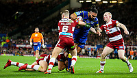 Warrington Wolves' Ben Murdoch-Masila is tackled by Wigan Warriors' Tony Clubb, George Williams and Liam Farrell<br /> <br /> Photographer Alex Dodd/CameraSport<br /> <br /> Betfred Super League Grand Final - Wigan Warriors v Warrington Wolves - Saturday 13th October 2018 - Old Trafford - Manchester<br /> <br /> World Copyright © 2018 CameraSport. All rights reserved. 43 Linden Ave. Countesthorpe. Leicester. England. LE8 5PG - Tel: +44 (0) 116 277 4147 - admin@camerasport.com - www.camerasport.com