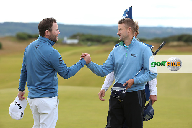 Branden Grace (RSA) shakes the hand of Russell Knox (SCO) during Round Two of the 2016 Aberdeen Asset Management Scottish Open, played at Castle Stuart Golf Club, Inverness, Scotland. 08/07/2016. Picture: David Lloyd | Golffile.<br /> <br /> All photos usage must carry mandatory copyright credit (&copy; Golffile | David Lloyd)