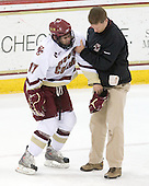 Brian Gibbons (BC - 17), Bert Lenz (BC - Trainer) - The Boston College Eagles defeated the University of Massachusetts-Amherst Minutemen 5-2 on Saturday, March 13, 2010, at Conte Forum in Chestnut Hill, Massachusetts, to sweep their Hockey East Quarterfinals matchup.