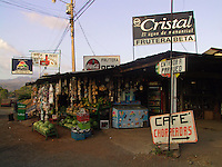 COSTA RICA , File Photo  Jan 31 2001<br /> Fruits and various snack food  hang from  cords in front of  a small food store / restaurant beside the road between Manuel-Antonio and San Jose in Costa Rica..