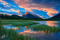 Clouds and Mt. Rundle  reflected in Vermillion Lakes at sunrise<br />