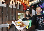 "Ortarius ""Spanky"" Williams (left) is the chef at the Kaskaskia River House, and is assisted by cook Jason Conaway. Here, ""Spanky"" holds up an Eggsquisite Burger -- an over-easy egg on a bun topped with onion straws and bacon bits, plus a side of home-made potato chips."