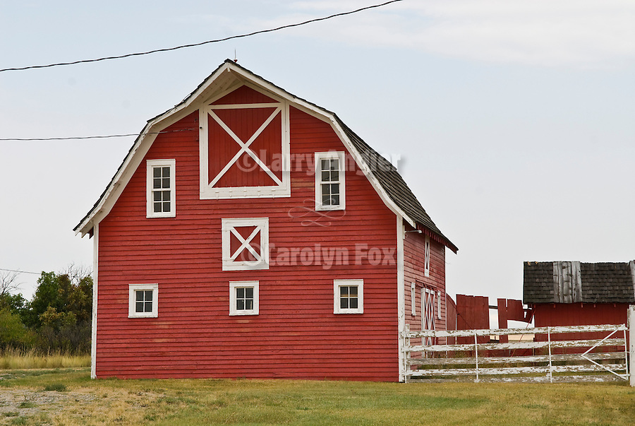 Red wooden barn, white trim in rural Montana