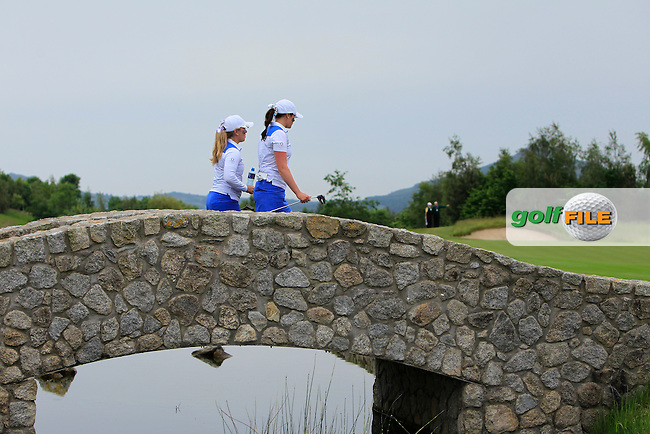 Bronte Law &amp; Olivia Mehaffey walk across a bridge to the 15th green during the Friday morning Foursomes of the 2016 Curtis Cup at Dun Laoghaire Golf Club on Friday 10th June 2016.<br /> Picture:  Golffile | Thos Caffrey