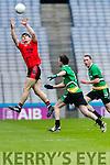 Gavin O'Grady Glenbeigh Glencar in action against  Rock Saint Patricks in the Junior Football All Ireland Final in Croke Park on Sunday.