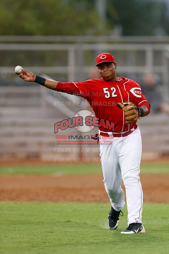 Kevin Franklin #52 of the AZL Reds makes a throw during a game against the AZL Padres at the Cincinnati Reds Spring Training Complex on July 13, 2013 in Goodyear, Arizona. AZL Reds defeated the AZL Padres, 11-10. (Larry Goren/Four Seam Images)