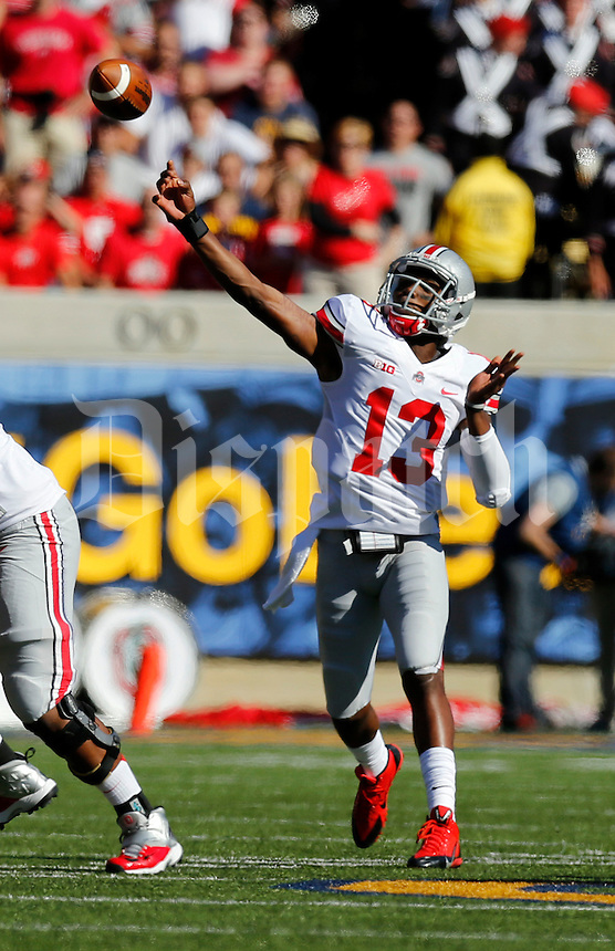 Ohio State Buckeyes quarterback Kenny Guiton (13) launches a 47-yard touchdown pass to wide receiver Devin Smith (9) during the first quarter of the NCAA football game at Memorial Stadium in Berkeley, California on Sept. 14, 2013. (Adam Cairns / The Columbus Dispatch)