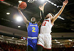VERMILLION, SD - JANUARY 24: Tevin King #2 from South Dakota State University is fouled while taking the ball to the basket by Trey Burch-Manning #12 from the University of South Dakota during their game Wednesday night at the Sanford Coyote Sports Center in Vermillion, SD. (Photo by Dave Eggen/Inertia)