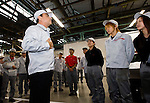 Carlos Ghosn, president and CEO of Nissan Motor Co., talks with employees during a tour of the automaker's engine assembly plant in Yokohama, Japan on Monday 26 Oct.  2009. .Photographer: Robert Gilhooly/Bloomberg News