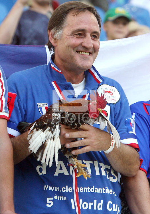French fan and his Coq. The Korea Republic and France played to a 1-1 tie in their FIFA World Cup Group G match at the Zentralstadion, Leipzig, Germany, June 18, 2006.