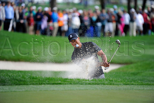 02.03.2013 Florida, USA. Tiger Woods hits his ball out of a bunker on the 11th hole during the third round of the Honda Classic at the PGA National Resort & Spa in Palm Beach Gardens, FL.
