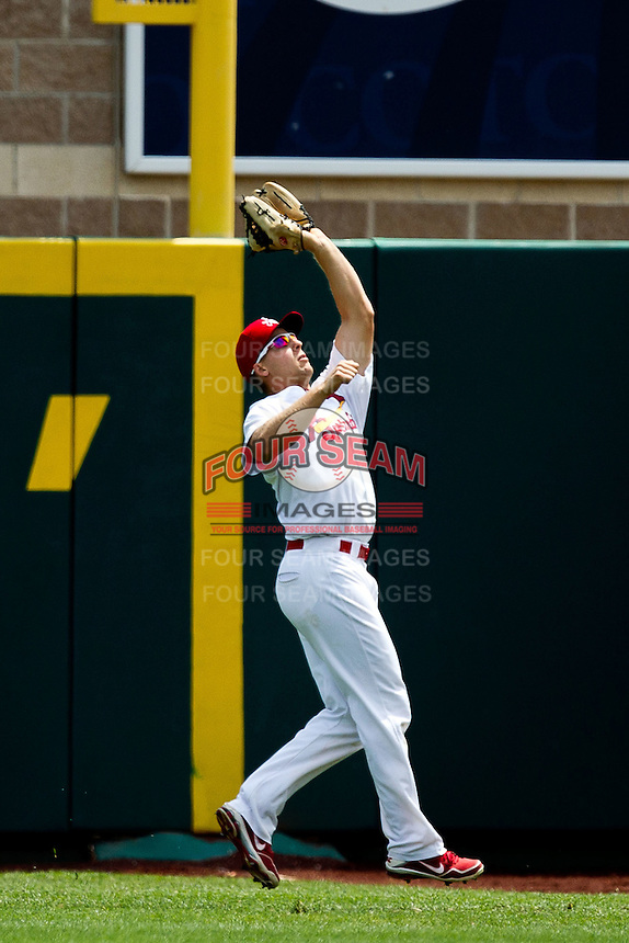 Kyle Conley (35) of the Springfield Cardinals catches a ball hit to right field during a game against the Arkansas Travelers at Hammons Field on May 8, 2012 in Springfield, Missouri. (David Welker/ Four Seam Images)