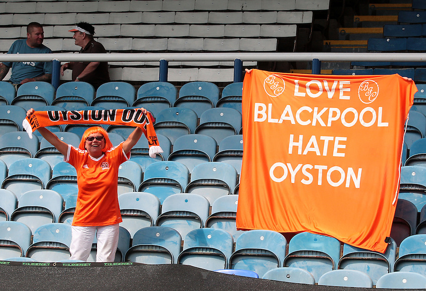 Blackpool fans vent their anger towards the clubs owners<br /> <br /> Photographer David Shipman/CameraSport<br /> <br /> Football - The Football League Sky Bet League One - Peterborough United v Blackpool  - Sunday 8th May 2016 - ABAX Stadium - London Road   <br /> <br /> &copy; CameraSport - 43 Linden Ave. Countesthorpe. Leicester. England. LE8 5PG - Tel: +44 (0) 116 277 4147 - admin@camerasport.com - www.camerasport.com