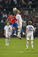 CARSON, CA – JANUARY 22: Chile forward Estaban Paredes (9) and USA midfielder Jeff Larentowicz (8) during the international friendly match between USA and Chile at the Home Depot Center, January 22, 2011 in Carson, California. Final score USA 1, Chile 1.