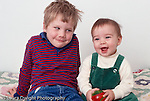 portrait of 4 year old boy with 7 month old baby sister horizontal