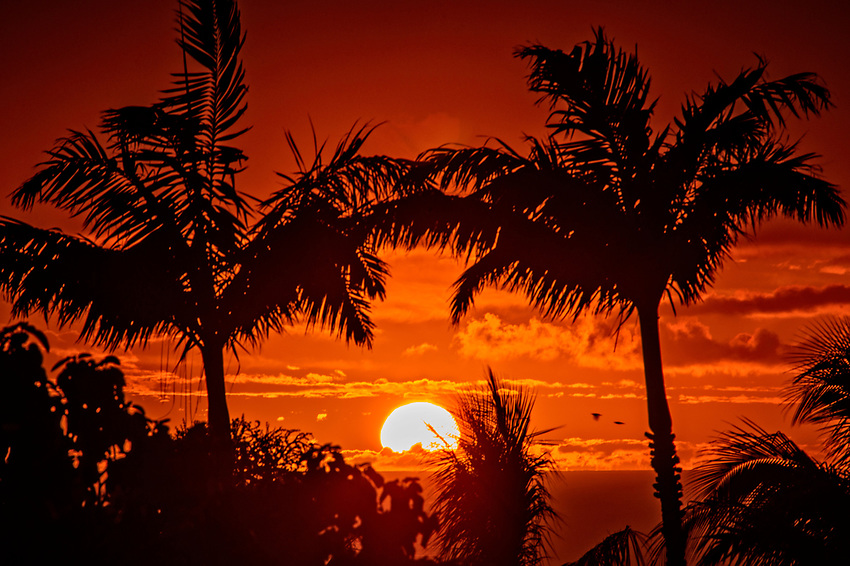 A sunset as seen from a lanai on a hill in Kihei, Maui