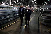 Bedford Heights, OH - January 16, 2009 -- United States President Elect Barack Obama (L) walks with John Grabner (R) president of Cardinal Fastener & Specialty Company, Inc., in Bedford Heights, Ohio, USA, during a tour of the company on 16 January 2009.  Obama met with workers at the plant , which manufactures parts used to construct wind turbines, and spoke about an American Recovery and Reinvestment Plan, which would aim to create nearly half a million American jobs by investing in clean energy.  .Credit: David Maxwell - Pool via CNP