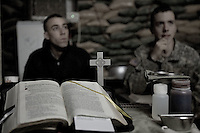 "US ARMY soldiers  from  A company, 1st battalion, 506th, 101st airborne division participate at a catholic mass lead by Chaplain Father Paul Halladay (CPT) at static observation post OP HOTEL on the afternoon of Wednesday February 02 2006 in Eastern Ramadi, Iraq. Father Paul Halladay is the 1st Battalion Chaplain, living side by side with his soldiers, he provides spiritual guidance in such difficult times of war. He wrote a prayer, "" The Blessing of Soldiers and their Weapons"". the prayer reads, ""Lord we recognize that human conflicts which result in war are never good and thus are not what you will for us, the most beloved of all your creation.  Due to the sin of Adam and humanity?s ongoing sinfulness, war, at times, becomes necessary to protect the innocent, free the oppressed, and restore peace.  May these weapons be used for such a just purpose and bless those, Lord, who, in service to their country, are called upon to wield them.  Protect them and keep them safe from all spiritual and mortal harm in performing what protection of the innocent, freedom for the oppressed and the restoration of peace requires of them.  Amen!""."