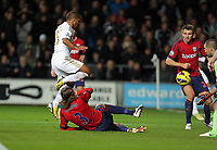 Sunday, 28 November 2012<br /> Pictured: Wayne Routledge of Swansea (L in white) avoids a tackle by Jonas Olsson of West Bromwich Albion (3) to score a goal, making the score 2-0 for his team<br /> Re: Barclays Premier League, Swansea City FC v West Bromwich Albion at the Liberty Stadium, south Wales.