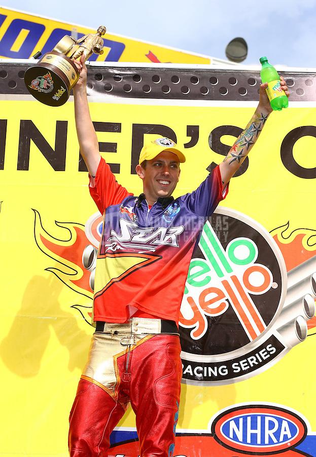 Jun. 2, 2013; Englishtown, NJ, USA: NHRA pro stock motorcycle rider Michael Ray celebrates after winning the Summer Nationals at Raceway Park. Mandatory Credit: Mark J. Rebilas-