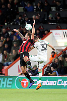 Steve Cook of Bournemouth and Dennis Srbeny of Norwich City both go for the aerial ball during AFC Bournemouth vs Norwich City, Caraboa Cup Football at the Vitality Stadium on 30th October 2018