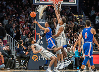 WASHINGTON, DC - DECEMBER 28: Stacy Beckton JR. #2 of American knocks over Jagan Mosely #4 of Georgetown. during a game between American University and Georgetown University at Capital One Arena on December 28, 2019 in Washington, DC.